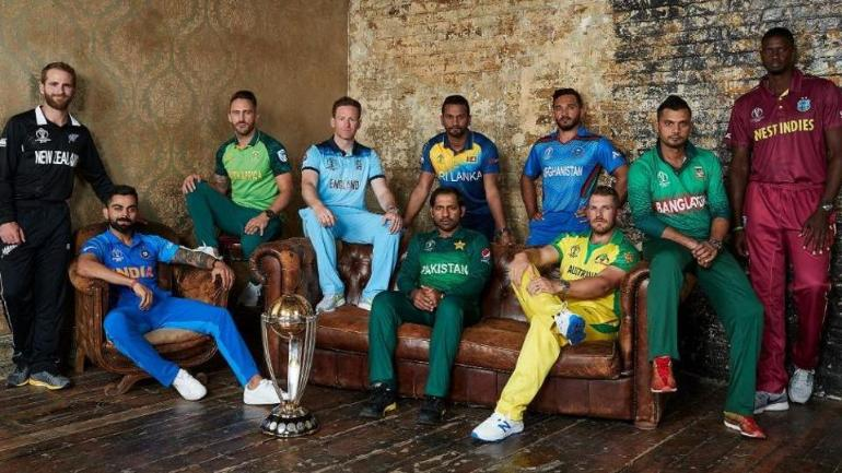 The captains of all 10 teams pose with the World Cup Trophy   दक्षिण अफ्रीका